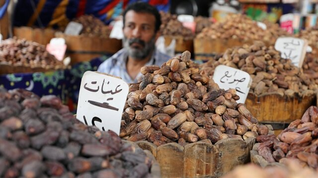 Dates are sold at a market ahead of the Muslim fasting month of Ramadan in Cairo Egypt
