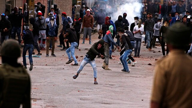 Demonstrators throw stones towards the Indian police during a protest against the recent killings in Kashmir, in Srinagar May 8, 2018.