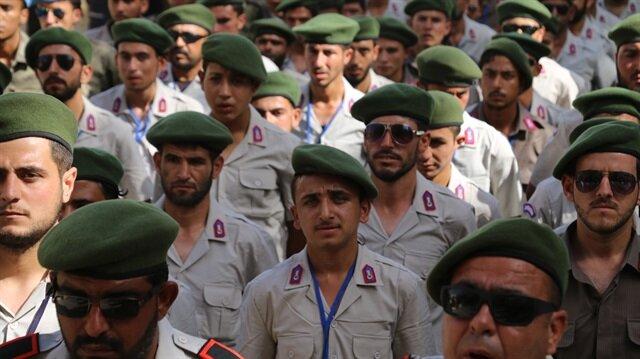 Polis Akademisi Başkanlığının katkılarıyla eğitim alan Suriyeli polisler, Afrin kent merkezinde düzenlenen yemin törenine katıldı.