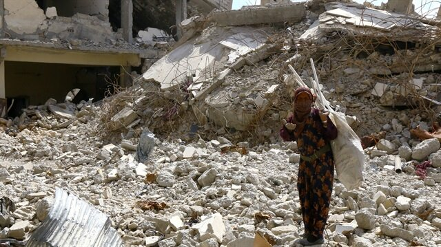 File Photo: A woman gestures as she stands on rubble of damaged buildings in Raqqa, Syria May 14, 2018.