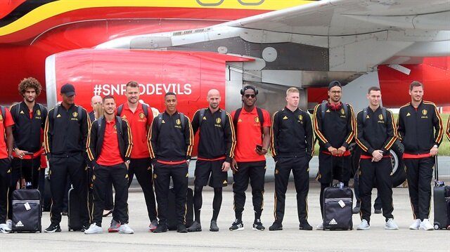 Belgian national soccer team players pose on the tarmac before their departure to Russia, at Brussels' national airport in Zaventem, Belgium June 13, 2018.