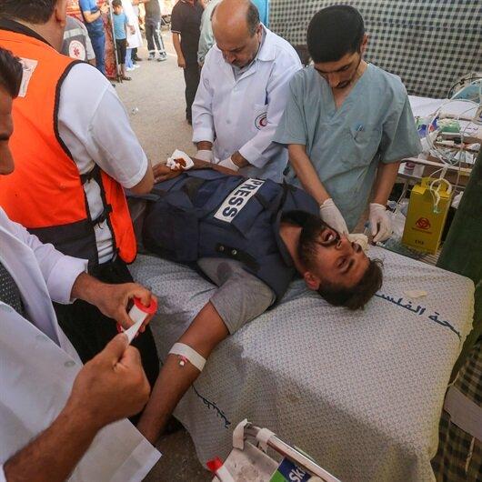 İsrail askerleri AA foto muhabirini 'gerçek mermiyle' yaraladı