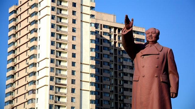 File Photo: A statue of former Chinese chairman Mao Zedong is seen in front of a residential building in Dandong New Zone, Liaoning province, China.
