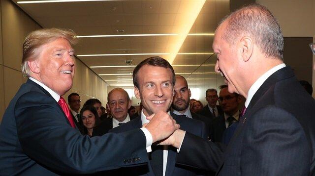 Başkan Erdoğan ile Donald Trump el sıkıştı. Karede Fransa Cumhurbaşkanı Macron yer aldı.