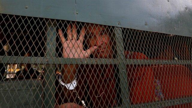 File photo: Australian filmmaker James Ricketson gestures inside a prison truck as he arrives at the Municipal Court of Phnom Penh, Cambodia, June 15, 2018.