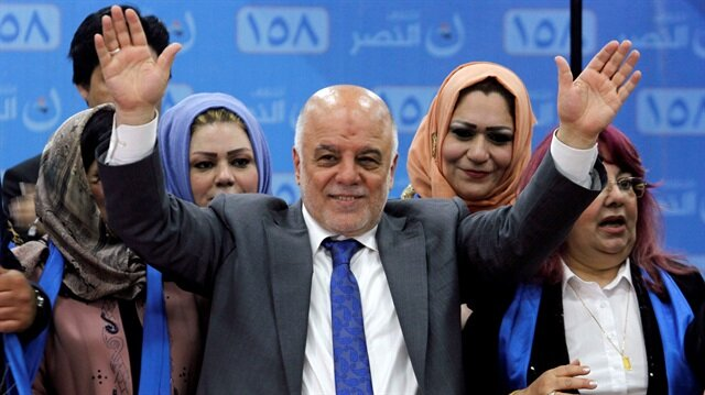 FILE PHOTO: Iraqi Prime Minister Haidar al-Abadi attends the election campaign, along with his supporters in Kirkuk, Iraq.