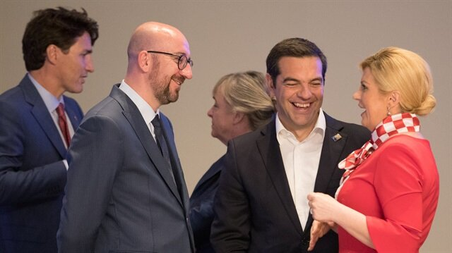 Prime Minister of Canada Justin Trudeau, Belgian Prime Minister Charles Michel, Prime Minister of Greece Alexis Tsipras and Croatia President Kolinda Grabar-Kitarovic are seen prior a working dinner at the Parc du Cinquantenaire during the NATO Summit in Brussels, Belgium.