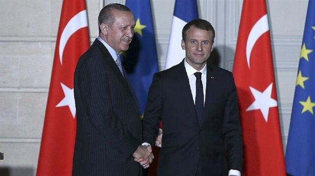 أردوغان رفقة الرئيس الفرنسي إيمانويل ماكرون