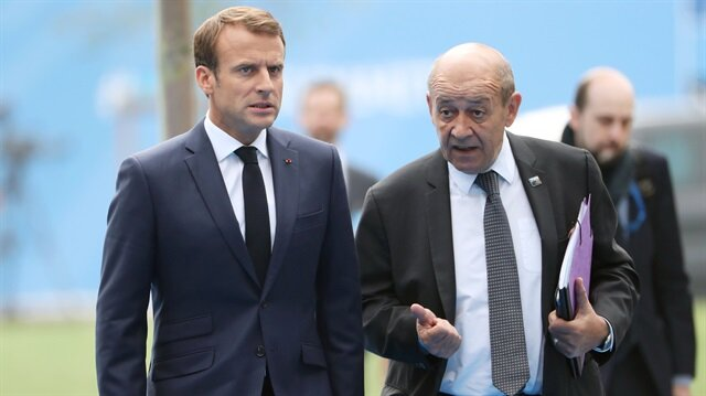 French President Emmanuel Macron and France's Foreign Minister Jean-Yves Le Drian