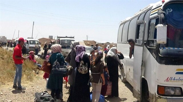 Buses arrive to evacuate two besieged pro-Assad Syrian villages