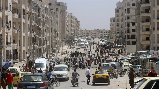 File photo: People inpect the damaged buildings after an explosion was carried out with a bomb-laden vehicle in Idlib