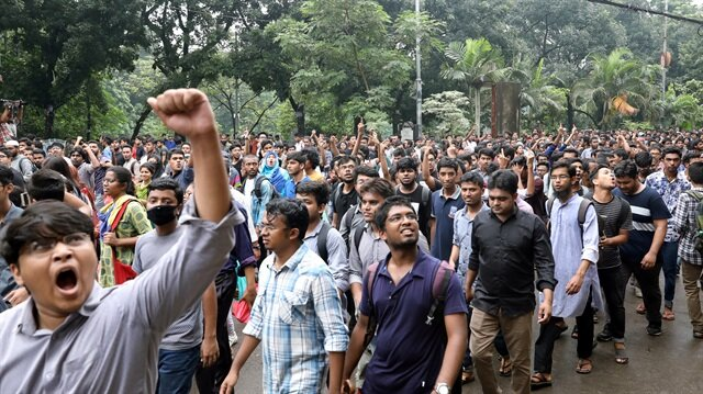 Students shout slogan during a rally as they join in a protest over recent traffic accidents that killed a boy and a girl, in Dhaka, Bangladesh.