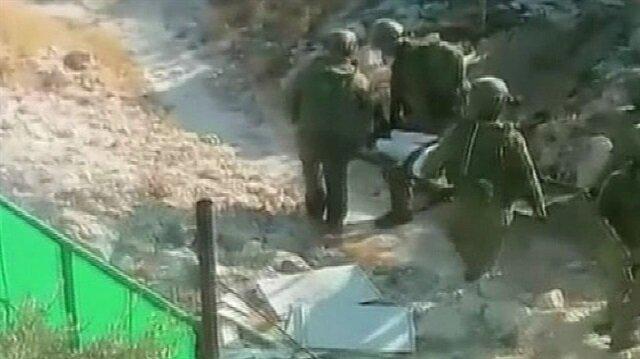 İsrail yaşlı Filistinliyi sedye ile gözaltına aldı