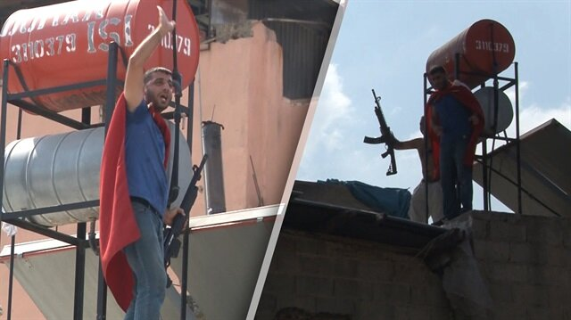 Evlerini yıktırmak istemeyen eylemciler tüfekle çatıya çıktı