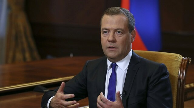 Russian Prime Minister Dmitry Medvedev speaks during an interview with Russia's Kommersant newspaper at the Gorki state residence outside Moscow
