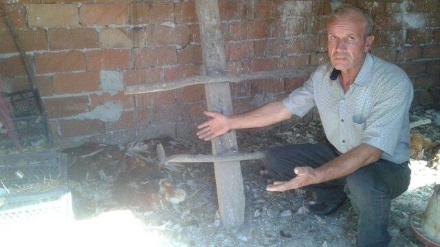 Çiftlik sahibi Adnan Yuvarlak, tavuk ve hindilerinin telef olduğunu görünce gözyaşlarını tutamadı.
