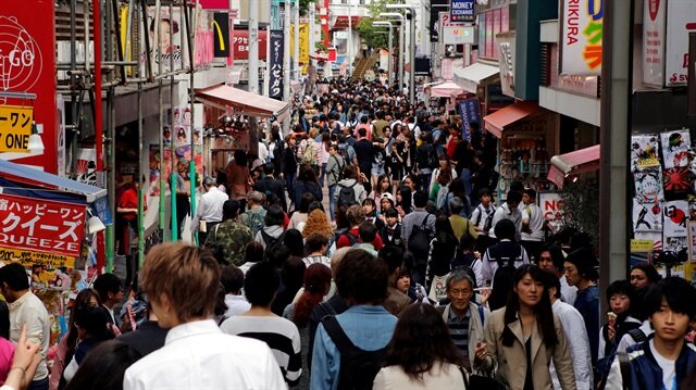 FILE PHOTO - People walk on a street in a busy shopping district in Tokyo, Japan.