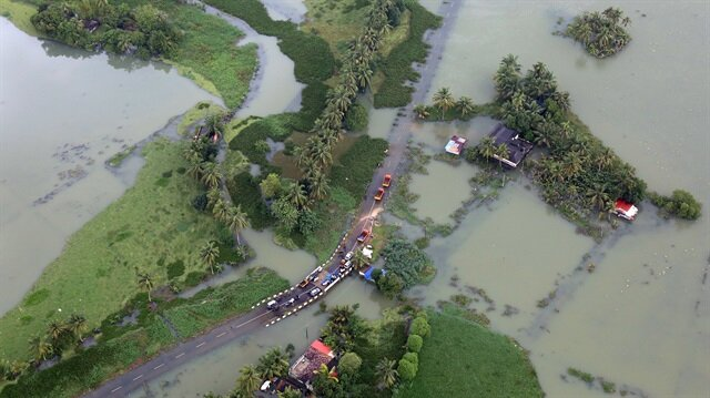 An aerial view shows partially submerged road at a flooded area i
