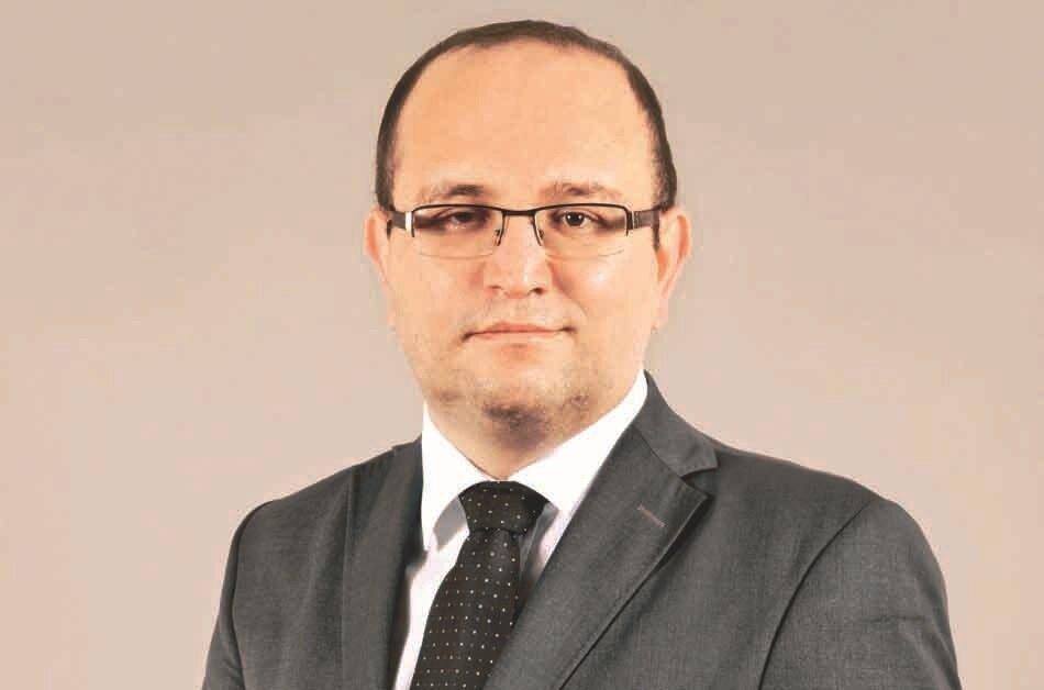 Director of Istanbul Universityâs Banking Research Center Kadir Tuna