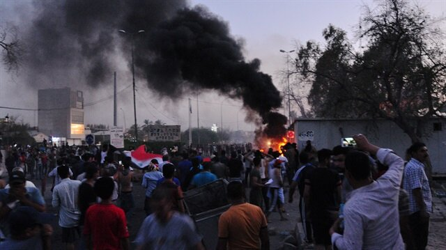People gather during a protest near the main provincial government building because of the water pollution and poor services in Basra, Iraq