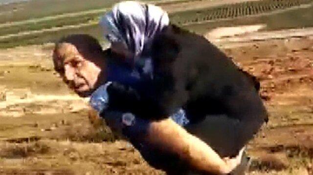 Başpolis, Suriyeli yaralı kadını sırtında 2 kilometre taşımıştı.
