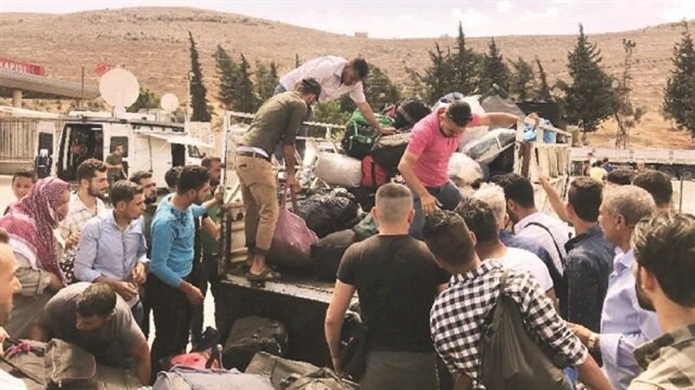 Idlib residents flee ahead of looming offensive against the northwestern Syria region