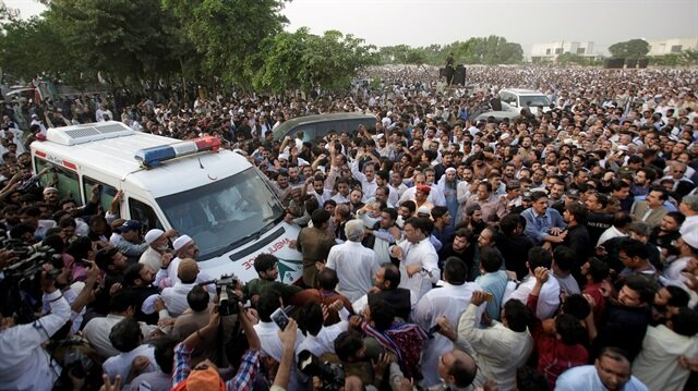 People gather near an ambuance as they attend funeral services for Kulsoom Sharif, the wife of former Prime Minister Nawaz Sharif who was temporarily released from prison, in Lahore, Pakistan September 14, 2018.