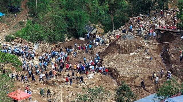Rescuers continue their search for missing people