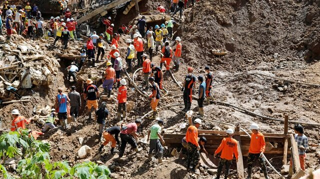 Rescuers continue their search for missing miners in a landslide caused by Typhoon Mangkhut at a small-scale mining camp in Itogon, Benguet in the Philippines, September 18, 2018.