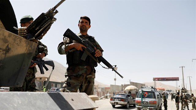 Afghan National Army (ANA) soldiers keep watch at a checkpoint