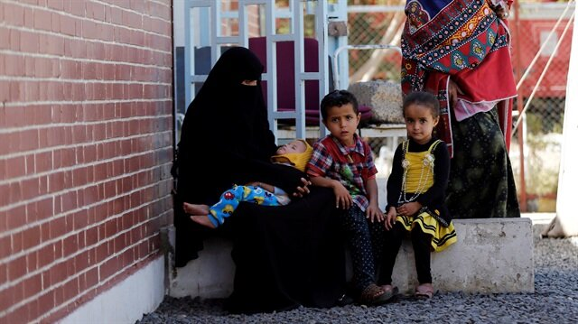 A woman and her children sits at a cholera treatment centre at the al-Sabeen hospital in Sanaa, Yemen