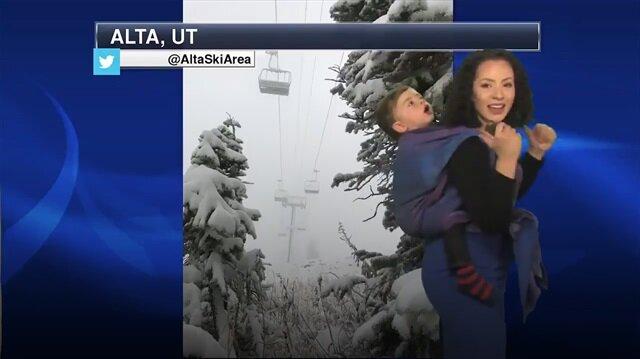 Spiker anne bebeğiyle hava durumunu sundu