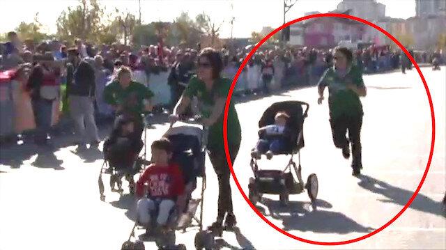 Anne-bebek yarışında bebek arabası takla attı!