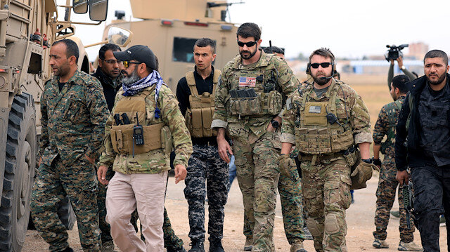 Syrian Democratic Forces and U.S. troops are seen during a patrol near Turkish border in Hasakah, Syria November 4, 2018.