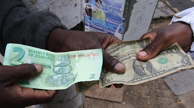 Illegal Money Changers Pose While Exchanging A New Zimbabwe Bond Note L And U S