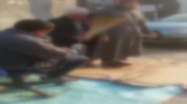 Süpürgeyle 'büyü bozarak' vatandaşı çarpan sahtekar kamerada