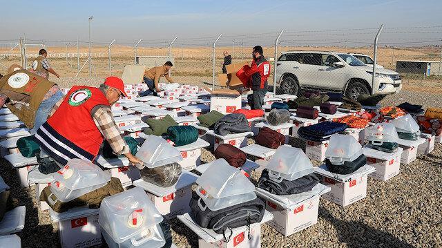 الهلال الأحمر التركي يوزع مساعدات إنسانية لنازحين عراقيين
