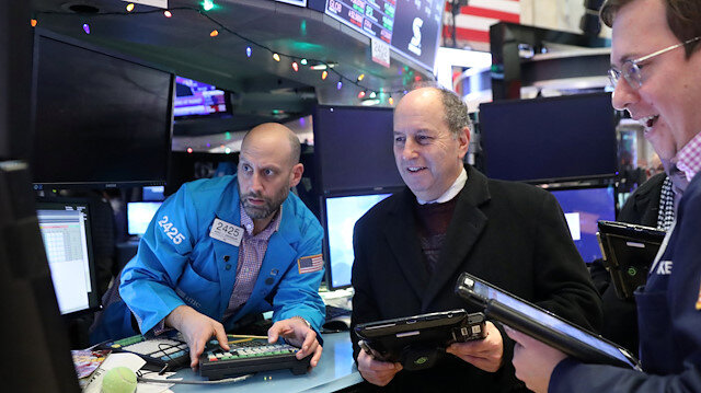 Traders work on the floor at the New York Stock Exchange (NYSE) in New York City, US.