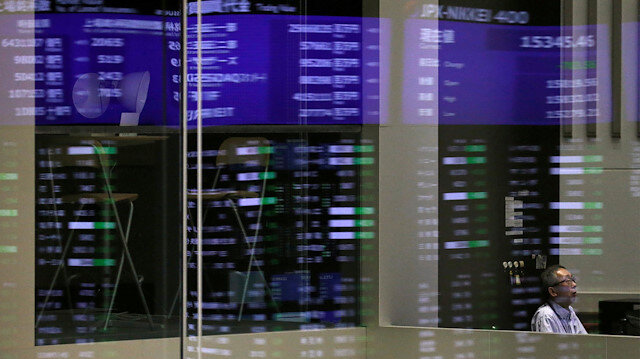 Market prices are reflected in a glass window at the Tokyo Stock Exchange (TSE) in Tokyo, Japan.