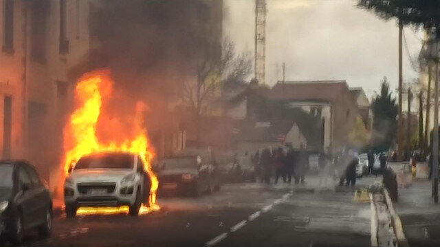 Car burns in Paris as high-school students protest