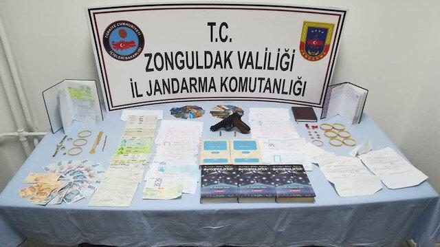 Operasyonda 25 milyon lira değerinde çek-senet, tapu ele geçirildi.