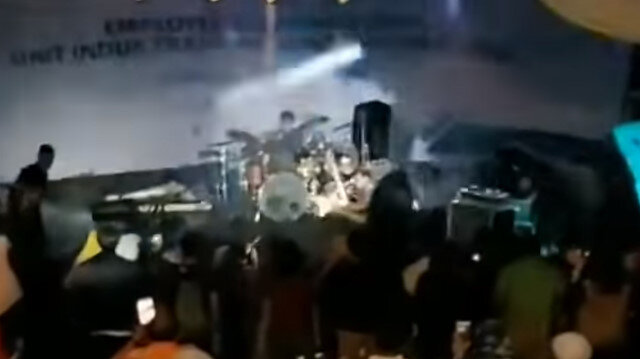 Partygoers screamed as tsunami waves smashed into a beachside concert in Indonesia, sending band members tumbling off a collapsing stage.