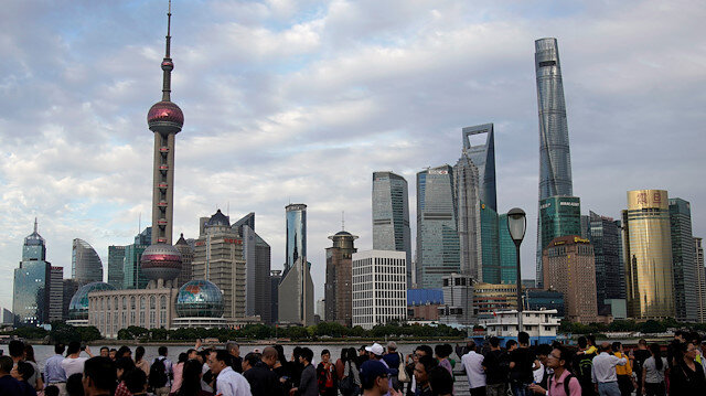 File photo: People visit the Bund in front of Shanghai's financial district of Pudong in Shanghai