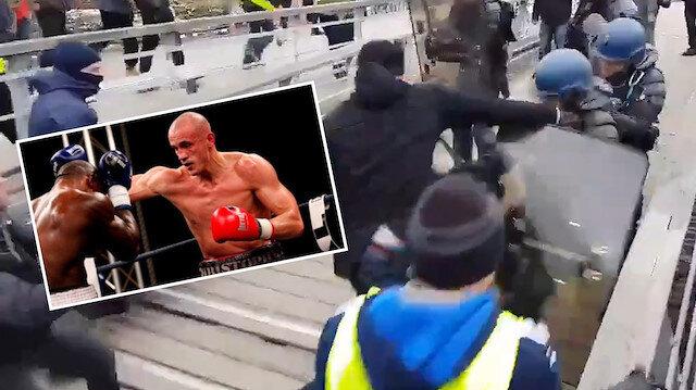 Şampiyon boksör sarı yeleklilere katılarak polis yumrukladı