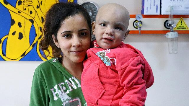 3 yaşındaki Ayşe'ye 8 yaşındaki abisi hayat verdi