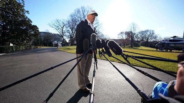 U.S. President Donald Trump talks to reporters