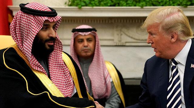 U.S. President Donald Trump shakes hands with Saudi Arabia's Crown Prince Mphammed bin Salman