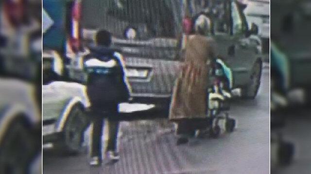 Bebek arabası süren kadınları hedef alan hırsızın amatör kamera tarafından çekilmiş fotoğrafı.