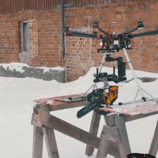 Dronea elektrikli testere bağlayıp ağaç kesti