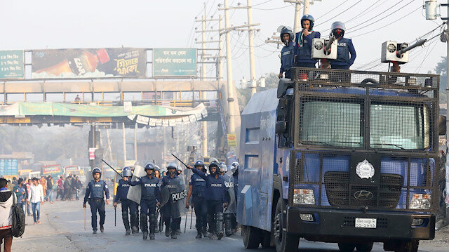 Police chase garments workers who have been protesting for higher wages, with water cannon at Ashulia, outskirt of Dhaka, Bangladesh, January 14, 2019.